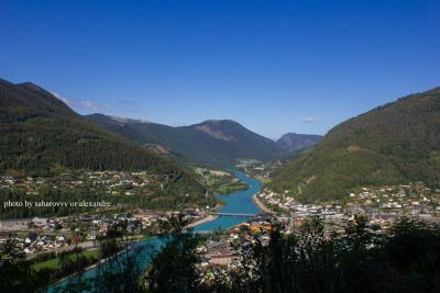 View of a mountain valley with a river below and houses. Norway. Otta