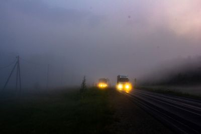 Morning photo of foggy road with purple sky