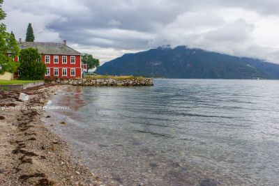 Beautiful houses on the shore of the fjord in Balestrand. Norway