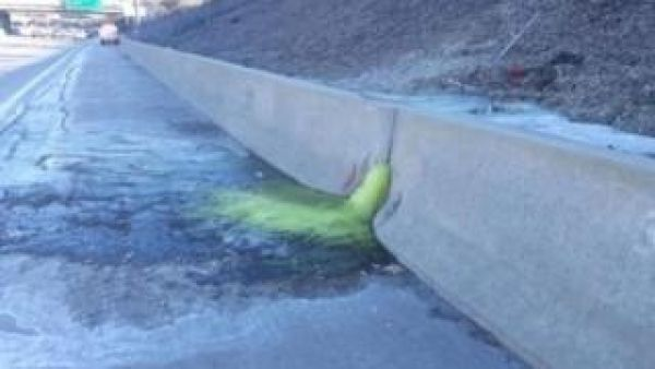 Hazardous green chemical oozes onto Detroit highway