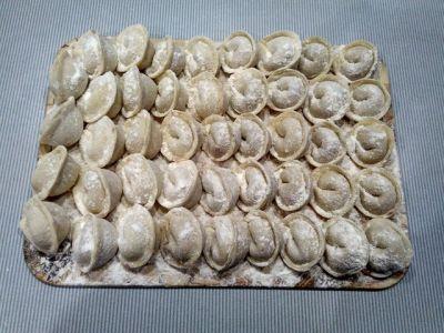 Traditional homemade Russian pelmeni.